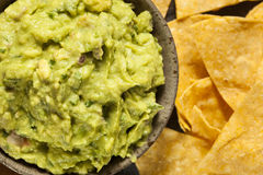 Green Homemade Guacamole with Tortilla Chips Stock Photos
