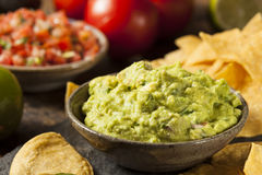 Green Homemade Guacamole with Tortilla Chips. And Salsa Royalty Free Stock Images