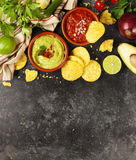 Green Homemade Guacamole with Tortilla Chips and Salsa Royalty Free Stock Images