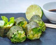 Green homemade vegan sushi rolls Stock Photos