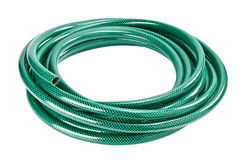Green hose. Green coiled rubber hose isolated on white Royalty Free Stock Photos