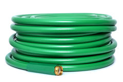 Green Hose. Garden hose isolated white background royalty free stock photo