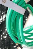 Green Hose. Green water hose on a boat stock photos