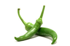 Green hot chili peppers Stock Photos
