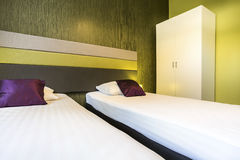 Green hotel room with two beds Royalty Free Stock Photo