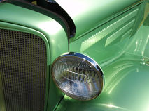 Green Hotrod. The lines and curves of a green hotrod Stock Photo