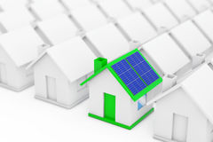 Green House with Blue Solar Panels in among White Houses. 3d Ren Stock Image