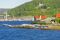 Green house and boats at Oslo fjord Royalty Free Stock Photography