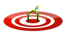 Green house in the center of a glossy red target. Royalty Free Stock Photos
