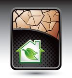 Green house on cracked bronze background Royalty Free Stock Photography