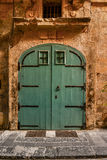 Green House door in Malta. House entrance door in Malta, painted in typical strong colors Stock Photography