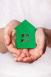 Green house in female hands. eco concept. Stock Image