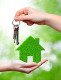 Green house in hand Royalty Free Stock Images