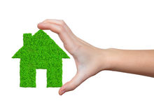 Green house in hands Royalty Free Stock Photography