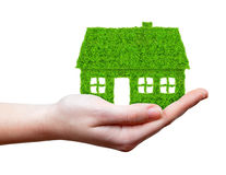 Green house in hands Royalty Free Stock Photos
