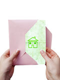 Green house icon. Green letter with house icon in a female hands Royalty Free Stock Photo
