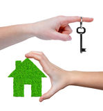 Green house with key in hands Stock Images