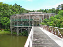 Green house like metallic building in the middle of the Atlantic rain forest. Wire frame steel work Royalty Free Stock Photography