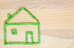 Green house made with wooden  toy blocks Royalty Free Stock Photo