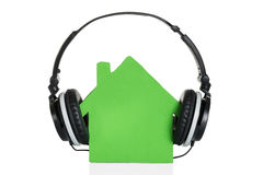 Green House Model With Headphone Stock Images