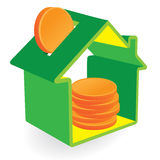 Green house moneybox with coins Stock Images