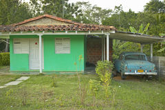 Green house and old car in carport in the Valle de Vi�ales, in central Cuba Stock Photography
