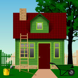 Green house on a plot with fence, tree and home tools Royalty Free Stock Photos
