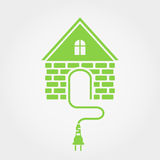 Green house with socket, home electricity icon Stock Photos