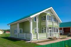 Green house in suburban neighborhood Royalty Free Stock Image
