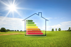 Green house in the sun with energy efficiency graph Royalty Free Stock Photography