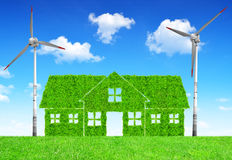Green house symbol with wind turbines Stock Image