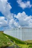 Green house under a blue sky Royalty Free Stock Photos