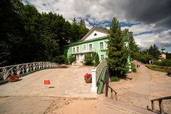 The bridge and the green house of the vicar in Pskov-Caves Monastery in Pechory Royalty Free Stock Photography