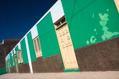 Green house wall with windows and door Stock Photos