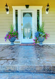 Green house with white door entrance. Royalty Free Stock Photo