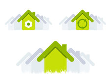 Green houses. An illustrated view of three green environmental houses or homes stock illustration