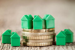 Green houses and coins Royalty Free Stock Image