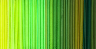 Green hue rolls of cloth. Kerala shop, India Royalty Free Stock Image