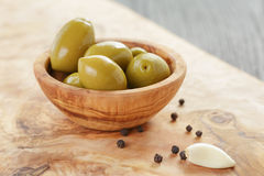 Green huge olives on wood table Royalty Free Stock Photo