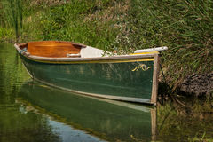 Green Hulled Boat Stock Photography