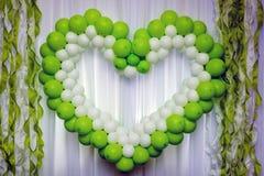 Green hurt made of balloons Stock Photos