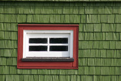 Green hut with red window. Red window in green, wooden hut. Interesting combinatin of colour Royalty Free Stock Image