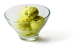 Green Ice-cream balls with fruit pieces. In transparent glass over white background Stock Images