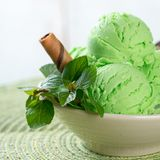 Green ice cream closeup. Close up mint ice cream on dining table stock images