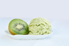 Green ice-cream with kiwi royalty free stock images