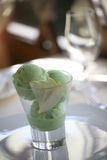 Green ice cream melting in a glass Stock Images