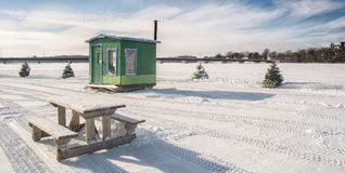 Green Ice Fishing Cabins in Ste-Rose Laval. Ice Fishing cabins in a vast spaces on the frozen Rivière des Mille Îles in Ste-Rose, Laval, Quebec, Canada Royalty Free Stock Image