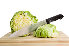 Green iceberg lettuce with knife on wooden choppin Stock Photo