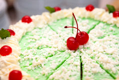 Green Iced Cake With Cherries Stock Photo