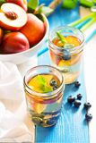 Green iced tea with nectarines and blueberries Royalty Free Stock Photo